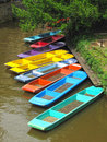 Colorful punts on river in Oxford Stock Images