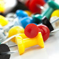 Colorful push pins on white background Stock Image