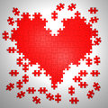 Colorful puzzle pieces in heart shape