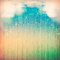 Colorful rain vintage abstract grange rainy landscape background clouds water drops blurred lights on the textured old paper Royalty Free Stock Images