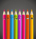 Colorful rainbow pencil happy face cartoon vector illustration layered for easy manipulation and custom coloring Royalty Free Stock Images