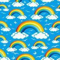Colorful rainbows and clouds pattern for seamless background Royalty Free Stock Photo