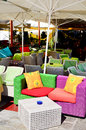 Colorful rattan  armchairs in a street coffee Royalty Free Stock Photo
