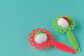 Colorful rattle baby toy isolated on blue background Royalty Free Stock Photo