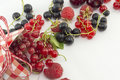 Colorful red berry fruit falling out of decorated box on white Royalty Free Stock Photo