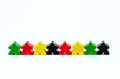 Colorful red green yellow and black wooden dolls on isolated background Royalty Free Stock Image