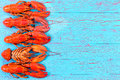 Colorful red lobster border on blue wood Royalty Free Stock Photo