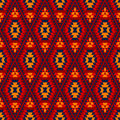 Colorful red yellow blue aztec diamond ornaments geometric ethnic seamless pattern vector background Royalty Free Stock Images