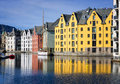 Colorful reflections of buildings alesund norway are reflected in the waterway known as alesundet in the coastal city in southwest Stock Image