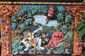 Colorful relief mural of ramayana hindu myth in bali characters from on wall balinese temple Stock Photo