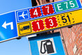 Colorful road signs with route numbers turn arrow and gas station icon Stock Photography