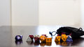 Colorful roleplaying dice scattered on a table with reflection Royalty Free Stock Photo