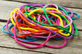 Colorful ropes on grey wooden background Royalty Free Stock Photo