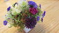 Colorful Rose Bouquet On Woode...