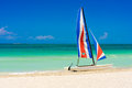 Colorful sailing boat in a cuban beach on the white sands of varadero cuba Stock Images
