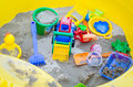 Colorful sand toys in sandbox a yellow Stock Images