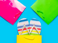 Colorful sandals in cool shopping bag near other beautiful shopp Royalty Free Stock Photo