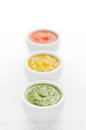 Colorful sauces three green yellow and red in a row Stock Photo
