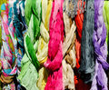 Colorful scarves on a rack Stock Image