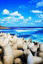 Colorful scene - blue sea, sky and puffy clouds Royalty Free Stock Images