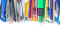 Colorful school supplies in the frame on a white background close up Royalty Free Stock Photo