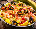 Colorful Seafood Paella Dish with Shellfish Royalty Free Stock Photo