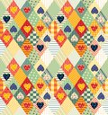 Colorful seamless patchwork pattern with rhombuses and hearts.