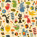 Colorful seamless pattern with happy monsters and flowers Stock Photography