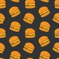 Colorful seamless pattern with tasty hamburgers on dark background. Juicy burgers or sandwiches, delicious fast food