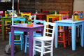 Colorful seats and tables in a garden restaurant at lake constance germany Royalty Free Stock Photos