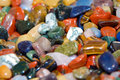 Colorful semi-precious stones in bulk. Royalty Free Stock Photo