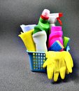 Colorful set of cleaning supplies in a blue basket with copy space. Royalty Free Stock Photo