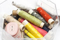 Colorful sewing supplies in box Stock Photos