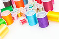 Colorful sewing thread on white Royalty Free Stock Photos