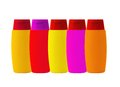 Colorful shampoo bottles on white backgroud Royalty Free Stock Photos