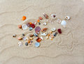 Colorful shells on beach with star Royalty Free Stock Photo