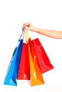 Colorful shopping bags set in woman's hand isolated on white Stock Images