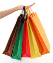 Colorful shopping bags set in womans hand isolated on white background Stock Photos