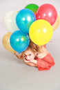 Colorful shot of teen girl with balloons fashion multicolored eyelashes and Royalty Free Stock Image
