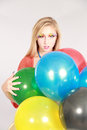Colorful shot of teen girl with balloons fashion multicolored eyelashes and Stock Photography