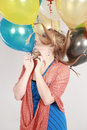 Colorful shot of teen girl with balloons fashion multicolored eyelashes and Royalty Free Stock Images