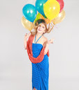 Colorful shot of teen girl with balloons fashion multicolored eyelashes and Stock Image