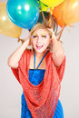 Colorful shot of teen girl with balloons fashion multicolored eyelashes and Royalty Free Stock Photography