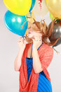 Colorful shot of teen girl with balloons fashion multicolored eyelashes and Royalty Free Stock Photos