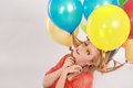 Colorful shot of teen girl with balloons fashion multicolored eyelashes and Stock Photo