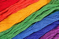 Colorful skeins of floss as background texture Royalty Free Stock Photo