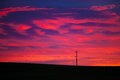 Colorful sky at sunrise with telephone pole and line Royalty Free Stock Photo