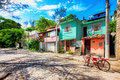 Colorful small houses along a cobbled street in Buzios, Brazil Royalty Free Stock Photo