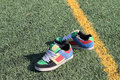 Colorful sneakers at the goal line Royalty Free Stock Photo