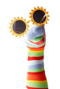 Colorful sock puppet with sunglasses Royalty Free Stock Photo